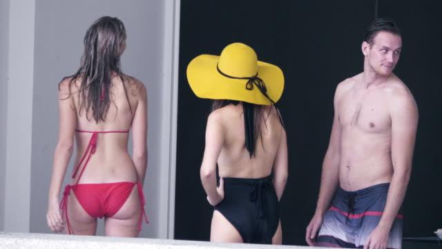 zoom in friends in bikinis - swimwear videos stock videos and b-roll footage