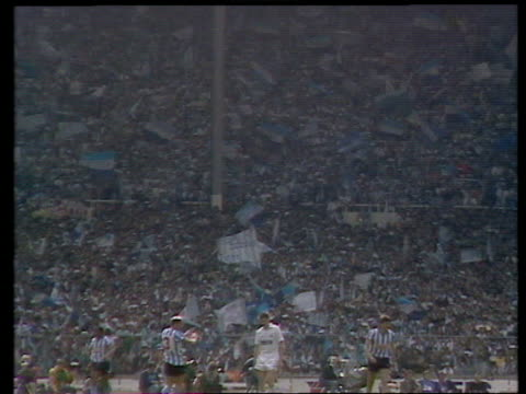 Zoom in from pitch to Coventry City fans waving flags Coventry City vs Tottenham Hotspur 1987 FA Cup Final Wembley London