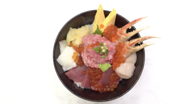 4k zoom in kaisen donburi or sashimi rice bowl on white table - donburi stock videos and b-roll footage