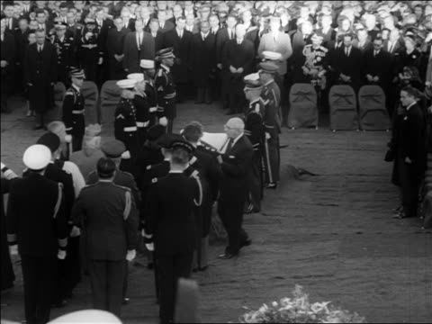 zoom in man giving folded american flag to jacqueline kennedy at jfk's burial - witwe stock-videos und b-roll-filmmaterial