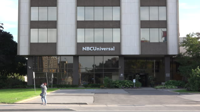 zoom in nbc universal or nbcuniversal studios building exterior nbcuniversal is an american multinational media conglomerate - nbc stock videos & royalty-free footage