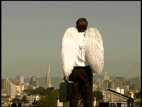 zoom in of businessman with wings - ängel bildbanksvideor och videomaterial från bakom kulisserna