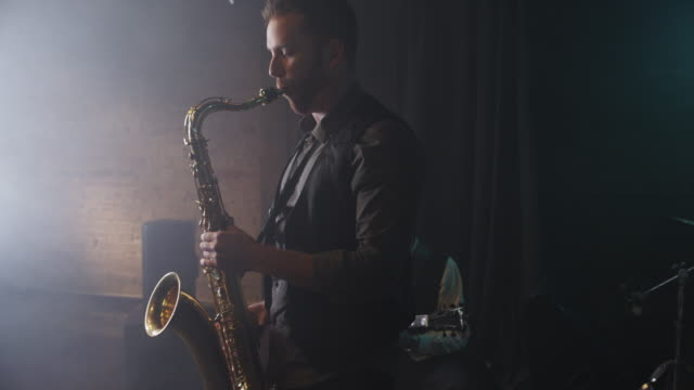 zoom in of musicians playing instruments / provo, utah, united states,  - performance group stock videos & royalty-free footage
