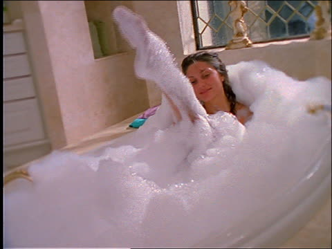 zoom in of woman in bubble bath - bubble bath stock videos and b-roll footage