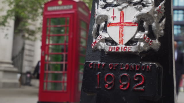 Zoom in on a decorative coat of arms on a lamppost in the City of London.