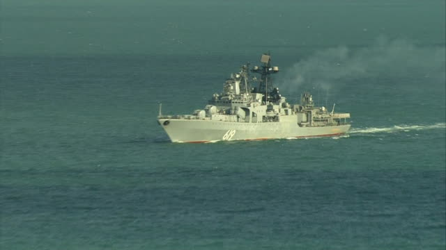 zoom in on a russian navy ship moving along the english channel - military ship stock videos and b-roll footage