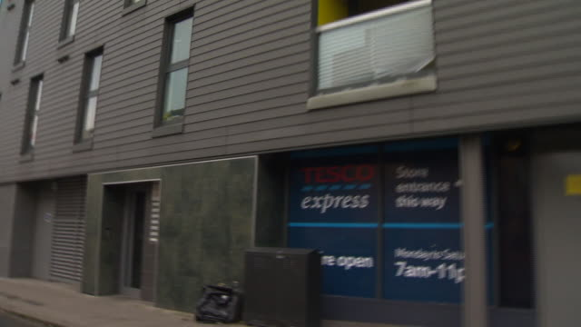 zoom in on a 'tesco express' store window sign - store sign stock videos & royalty-free footage