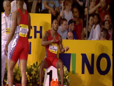 zoom in on bernard williams dancing sitting on his block at starting line men's 100m final 2003 international athletics grand prix crystal palace... - athleticism stock videos & royalty-free footage