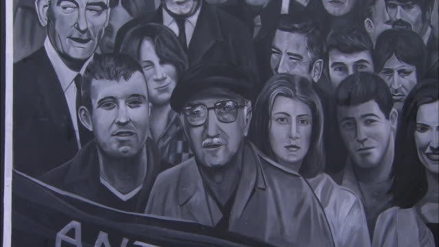 zoom in on civil rights wall mural to face in crowd, derry, londonderry, northern ireland - derry northern ireland stock videos & royalty-free footage