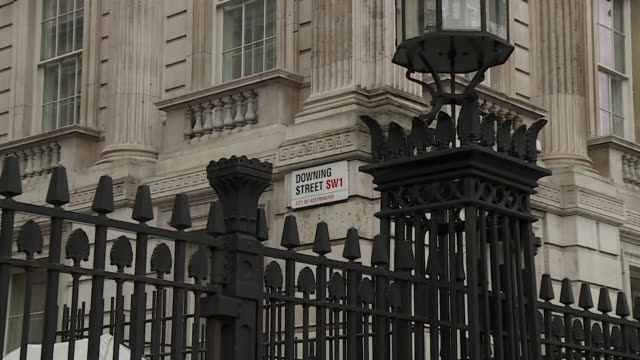 zoom in on downing street road sign - road sign stock videos & royalty-free footage