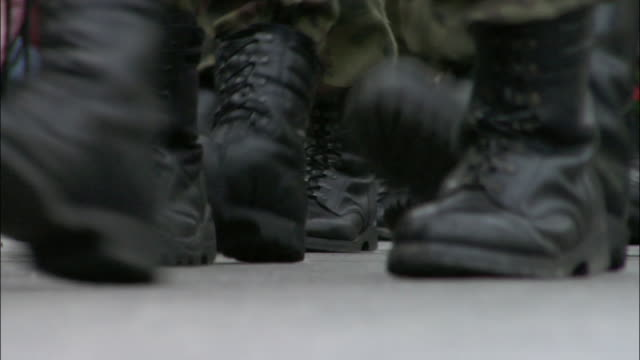 Zoom in on feet of soldiers marching in military parade / Krakow, Poland