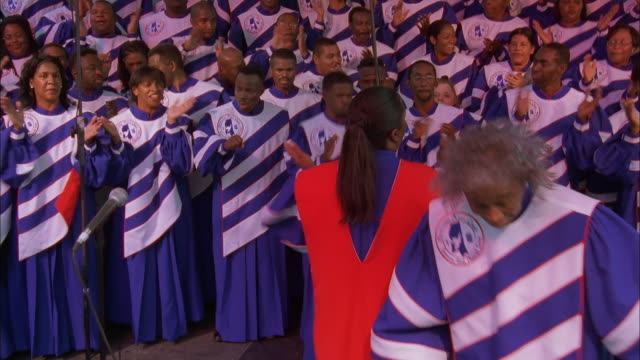 zoom in on gospel choir passionately singing and dancing on stage, jackson, mississippi available in hd. - spirituals musik stock-videos und b-roll-filmmaterial