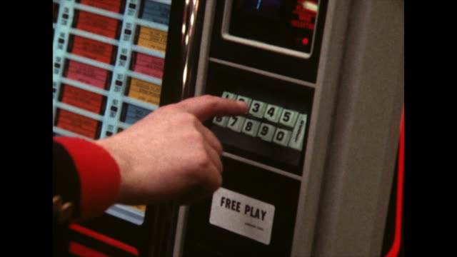 zoom in on hand choosing a track on a jukebox; 1980 - 1980 stock videos & royalty-free footage