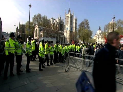 Zoom in on large group of Tamil protesters chanting in Westminster during demonstrations as police form barrier to block crowd 20 April 2009