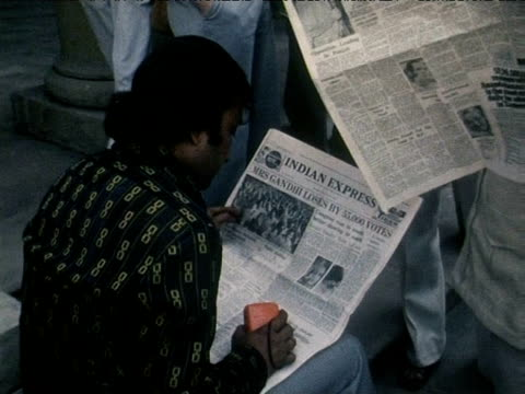 zoom in on man reading newspaper announcing indira gandhi's election defeat india 1970s - indira gandhi stock videos & royalty-free footage