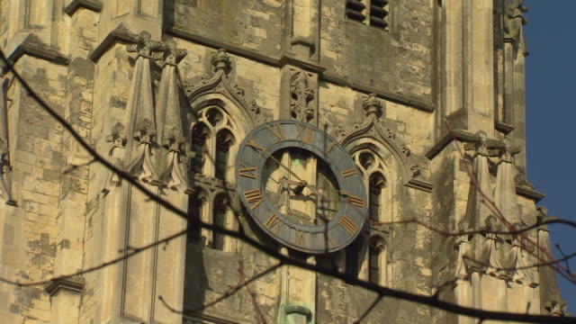 zoom in on the clock face on the exterior of canterbury cathedral. - canterbury cathedral stock videos & royalty-free footage