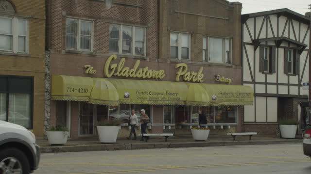 zoom in on the gladstone park bakery. brick building.