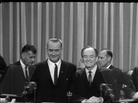 zoom in president lyndon johnson + hubert humphrey at podium / democratic national convention - 1964 stock videos & royalty-free footage