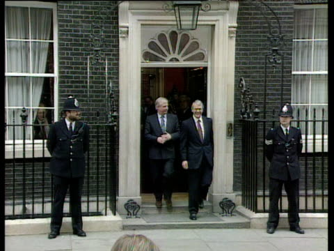 zoom in prime minister john major exiting 10 downing street with chris patten after general election victory waving to crowds 1992 general election... - john major stock-videos und b-roll-filmmaterial