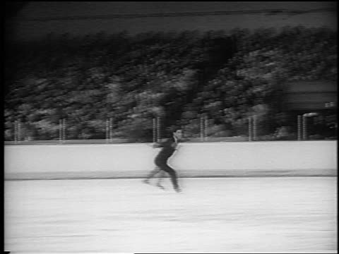 b/w 1965 zoom in scott ethan allen figure skating at world championships / colorado / newsreel - one teenage boy only stock videos & royalty-free footage
