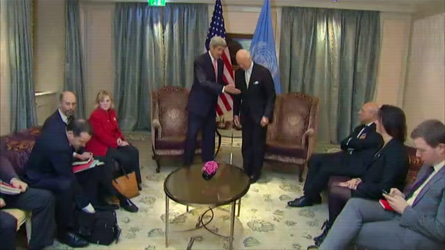 zoom in secretary of state john kerry shaking hands with un special envoy for syriaêstaffanêdeêmistura - (war or terrorism or election or government or illness or news event or speech or politics or politician or conflict or military or extreme weather or business or economy) and not usa stock-videos und b-roll-filmmaterial