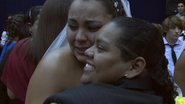 Zoom In Shot a lesbian couple emotionally pose for a photograph after saying 'I do' at what was billed as the world's largest communal gay wedding on...