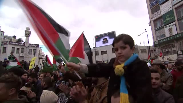 zoom in shot little boy waving palestinian flag at protest inêramallah palestine - palestinian flag stock videos & royalty-free footage