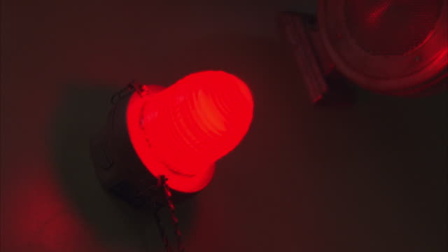 Zoom in shot of a red flashing light.