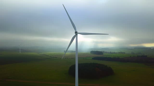 zoom in shot of a wind turbine in the countryside - northumberland stock videos & royalty-free footage