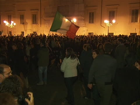 zoom in shot of citizens celebrating the resignation of prime minister silvio berlusconi he stepped down after failing to pass costcutting measures... - business or economy or employment and labor or financial market or finance or agriculture video stock e b–roll