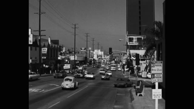 1968 zoom in shot of traffic moving on sunset boulevard, los angeles, california, usa - no parking sign stock videos & royalty-free footage