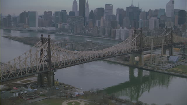 Zoom in shot of traffic moving on the Queensboro Bridge in Manhattan.