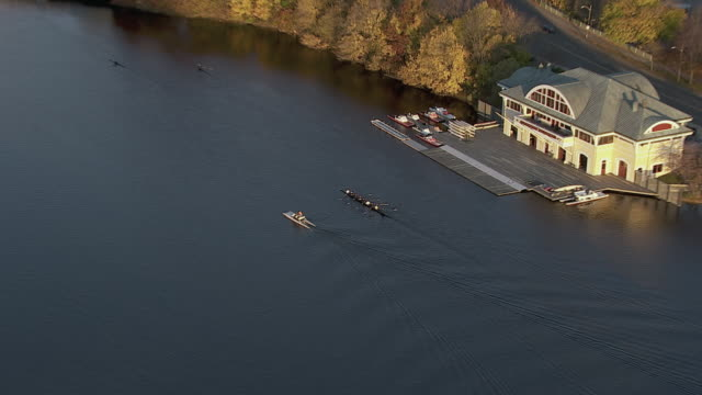 zoom in shot of women sculling crew rowing on charles river, cambridge, massachusetts, united states of america - massachusetts stock videos & royalty-free footage
