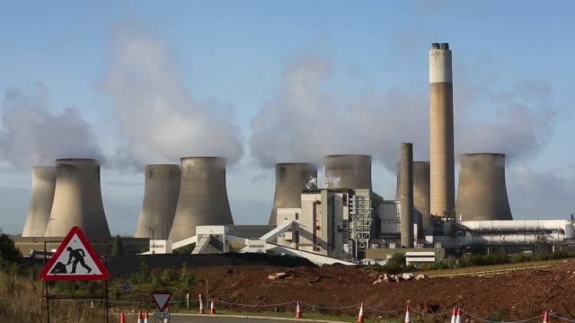 Zoom in Shot steam rises from the RatcliffeonSoar coal fired power station on October 17 2013 in Nottinghamshire England