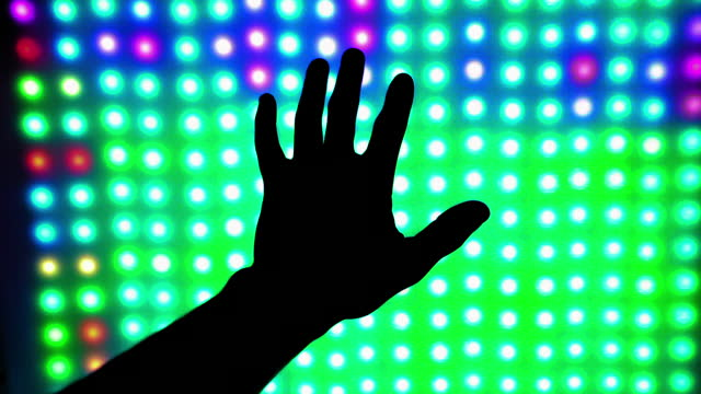 zoom in: silhouette hand against illuminated colorful light - sydney, australia - abstract stock videos & royalty-free footage