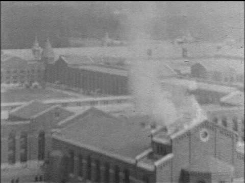 aerial zoom in smoke coming out of roof of attica state prison during riot / ny / newsreel - prison riot stock videos & royalty-free footage