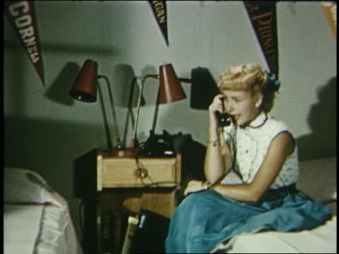 1957 zoom in teenage girl on phone in bedroom - landline phone stock videos and b-roll footage