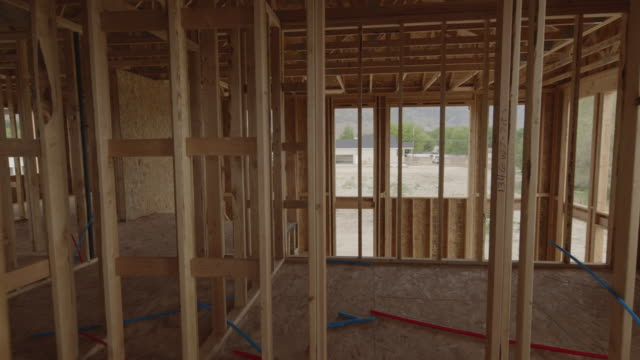 zoom in through framing of interior of house under construction / pleasant grove, utah, united states - new stock videos & royalty-free footage