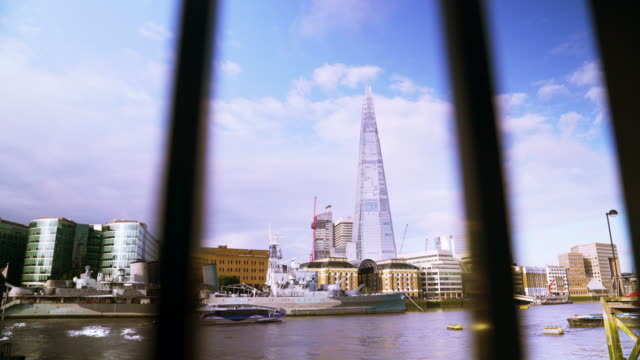 zoom in through railings onto the shard. - railings stock videos and b-roll footage