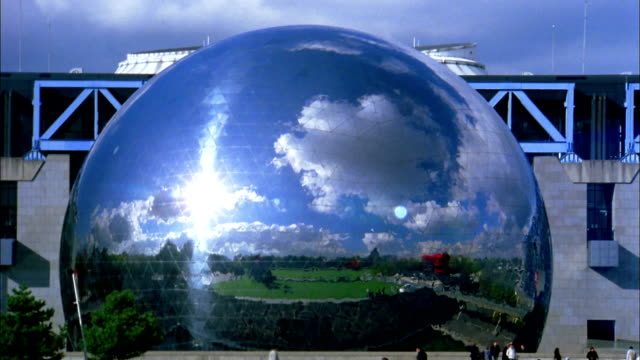 Zoom in time lapse clouds reflected in La Geode at Museum of Science and Industry / Paris, France