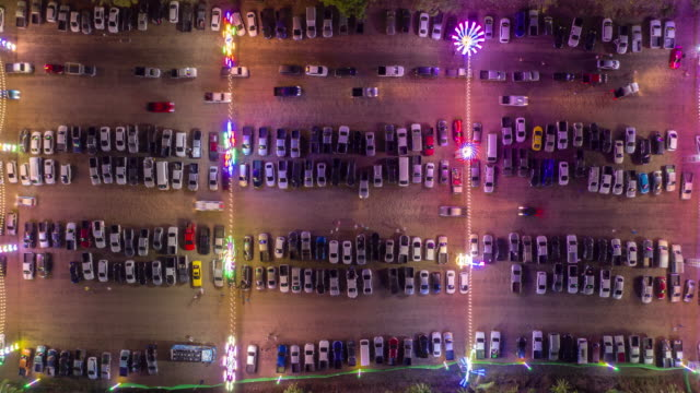 zoom in time lapse of parking lot in celebration event festival with colourful lighting - parking stock videos & royalty-free footage