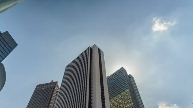4k zoom in time lapse office building and sky . - tilt up stock videos & royalty-free footage