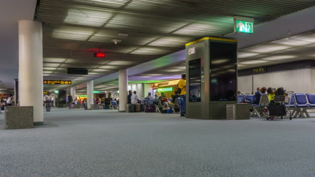 4k zoom in . timelapse airport passenger terminal - airport terminal stock videos & royalty-free footage