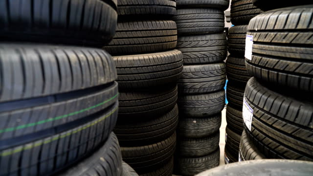 zoom in tires in auto parts store. - tyre stock videos & royalty-free footage