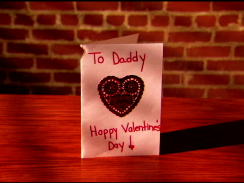 zoom in to a close-up of a homemade valentine for daddy on a table. - western script stock videos & royalty-free footage