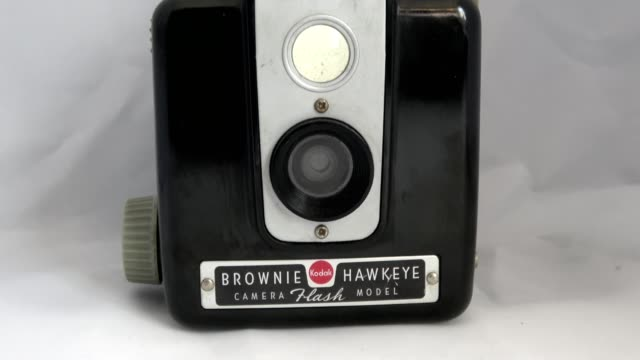zoom in to brownie hawkeye flash vintage camera from kodak with lens and logos visible on white background september 10 2019 - white background stock videos & royalty-free footage
