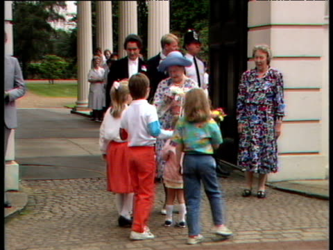 zoom in to children running up to queen mother to present her with flowers gifts and cards 88th birthday celebrations clarence house; 04 aug 88 - british royalty stock videos & royalty-free footage
