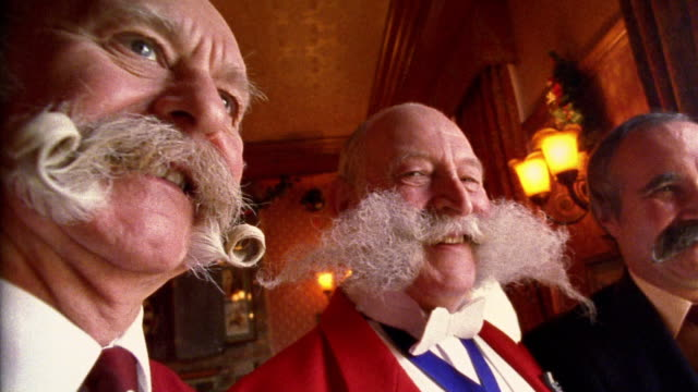 vídeos de stock e filmes b-roll de zoom in to close up of three older british men with elaborate mustaches - moustache