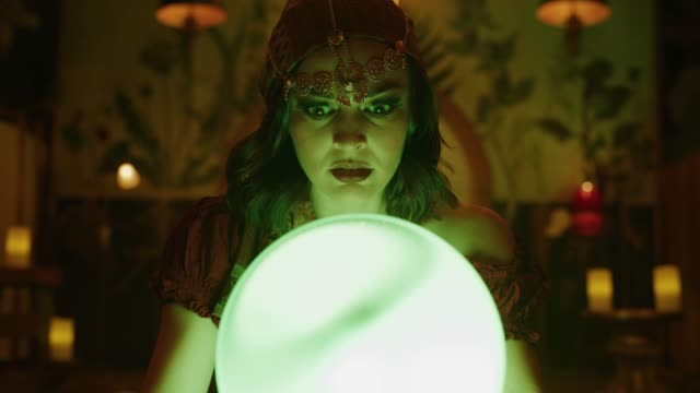 zoom in to concerned fortune teller looking down at crystal ball in nightclub / provo, utah, united states - eccentric stock videos & royalty-free footage