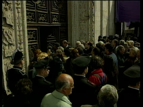 zoom in to crowds as they push through exterior door of san giovanni cathedral to view turin shroud on display for first time in 20 years turin 18... - occurrence stock videos & royalty-free footage